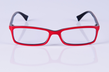 reading red glasses  close-up  on a light gray background photo