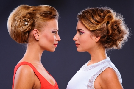 Portrait of a two beautiful sexy young women  look at each other  lovely hair