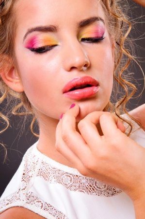 Beautiful woman with volume and shiny curly hair style, bright lips make-up  Stock Photo - 15199860