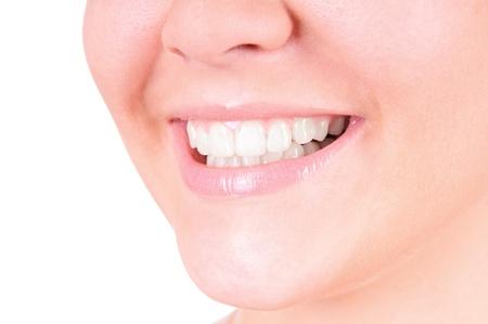 Woman smile. Teeth whitening. Dental care. closeup, isolates on white background photo