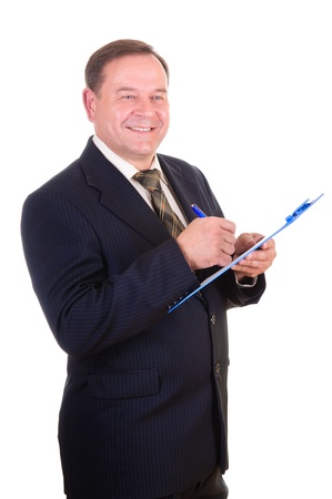 Portrait of a happy smart businessman pointing at clipboard isolated over white background  photo