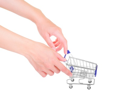human hands holding layout of blue shopping cart   isolated on white background  close-up photo
