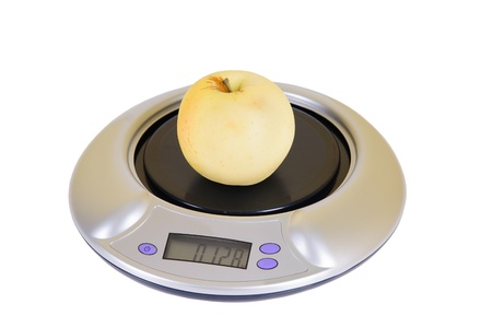 kitchen scales with Apple on white background Isolated photo