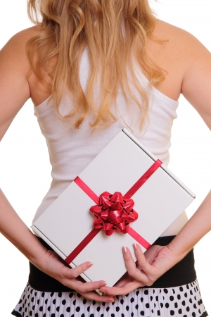 woman holding a present on her back  isolated on white background photo