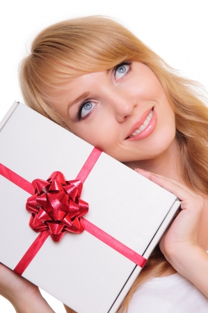 beautiful blonde holds a  gift box  Portrait isolated on white background photo