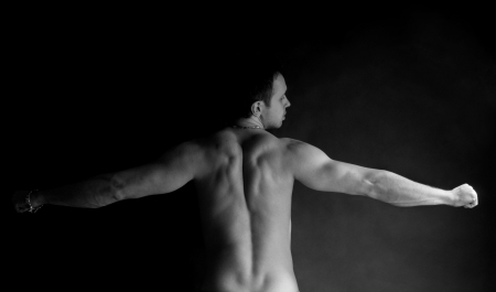 Portet muscular man with a beautiful body. black-and-white photo photo
