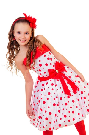 白い背景で隔離ポルカ ドット ドレス肯定的な肖像画で非常に小さなブロンドの女の子