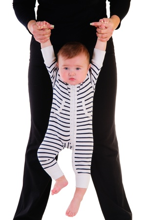 mother holding a little child by the hand  baby hanging and makes developing exercises  isolated on white background Stock Photo - 16595806
