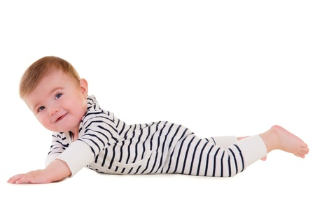 baby boy portrait isolated on white background. child  lying on his stomach on the floor and makes developing exercises Stock Photo - 17053512