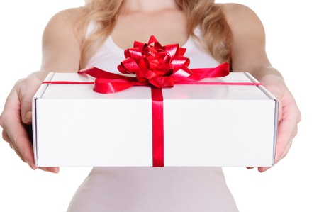 Hands holding beautiful gift box, female giving gift, Christmas holidays and greeting season concept, shallow dof Stock Photo - 17670925