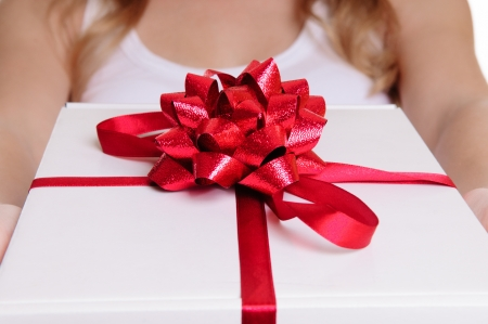 Hands holding beautiful gift box, female giving gift, Christmas holidays and greeting season concept, shallow dof Stock Photo - 17670926