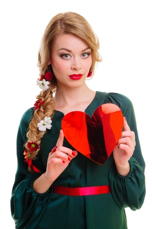 Valentines Day  Woman holding Valentines Day heart sign with copy space  photo