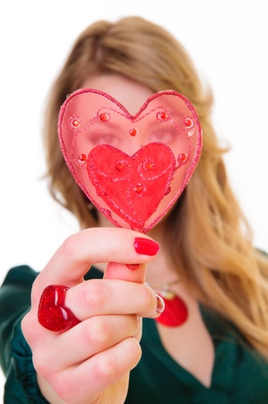 Valentines Day. blonde woman holding gift heart Shape.  photo