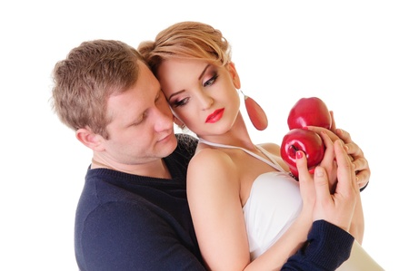 Couple in love - Caucasian man and woman holding red apples in hands, isolated on white background photo