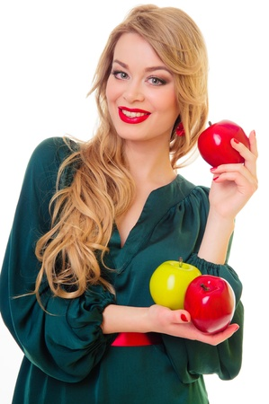 beautiful blond woman holding three fresh apple. girl in a green dress. isolated on white background photo