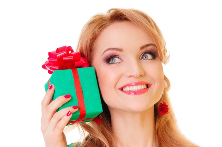 blonde woman holding  gift box. positive portrait isolated photo