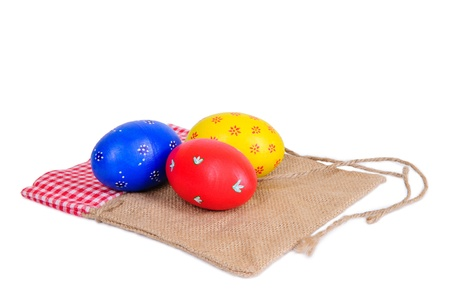multi-colored Easter eggs, painted by hand  wooden texture  isolated on white photo