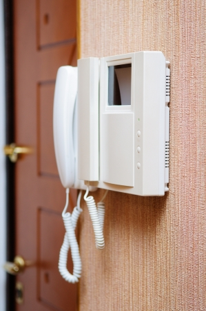 Security intercom speaker lcd monitor over new stucco wall