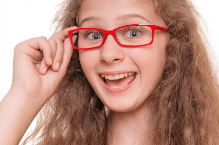 opthalmology: Beautiful smiling teenage girl with reading glasses  isolated on white background