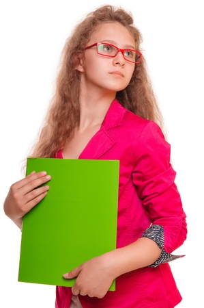 serious teen girl in glasses  holding a folder for papers  portrait isolated on white background photo