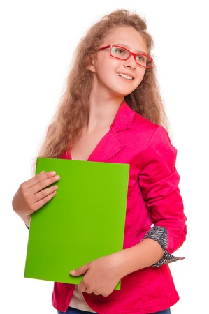 cheerful teen girl in glasses  holding a folder for papers  portrait isolated on white background photo