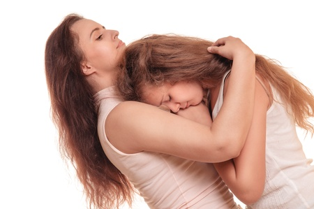 fracas: mother comforting her sad daughter  people isolated on a white background, in studio