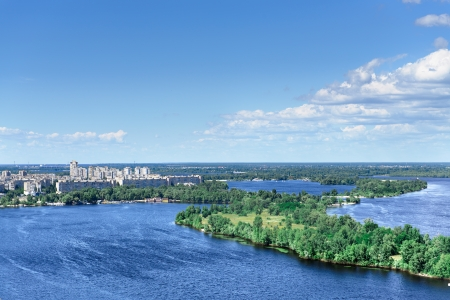 dnieper: blue sky with cloud and wide river. a city with tall buildings. Kiev. Ukraine Stock Photo