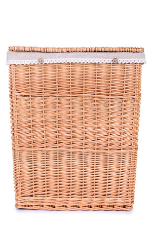 clothes basket with straw isolated on white background