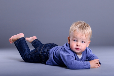 portrait of cute little caucasian baby lies. baby 1 year Stock Photo