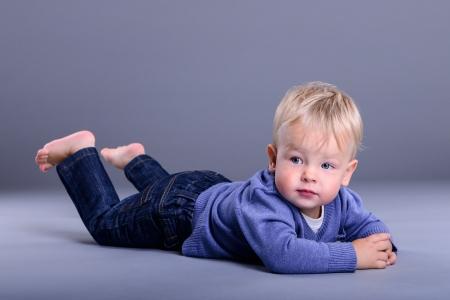 portrait of cute little caucasian baby lies. baby 1 year Zdjęcie Seryjne
