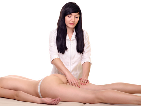 brunette masseur makes cellulite massage by patient. isolated on white  photo