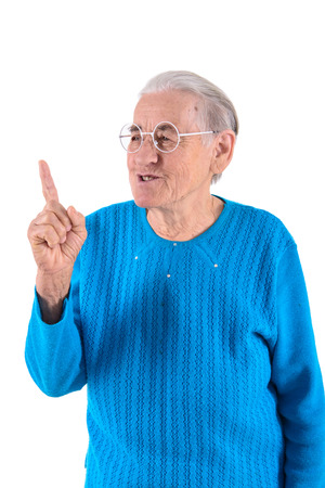 senior woman in glasses thumbs up.portrait isolated on white  photo