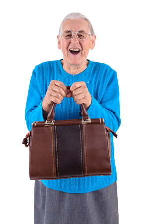 happy senior woman in glasses holding bag.portrait isolated on white  photo