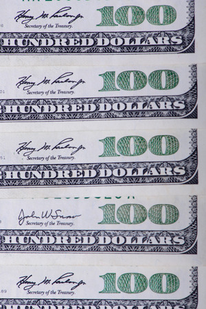 hundred dollar bill: One hundred banknotes as a background close-up Stock Photo