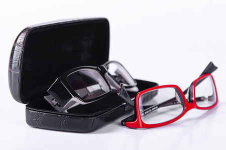 two optical glasses on a light gray background in a case photo