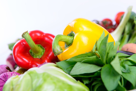 eating healthy: peppers and different ripe vegetables healthy eating vegetarian Stock Photo
