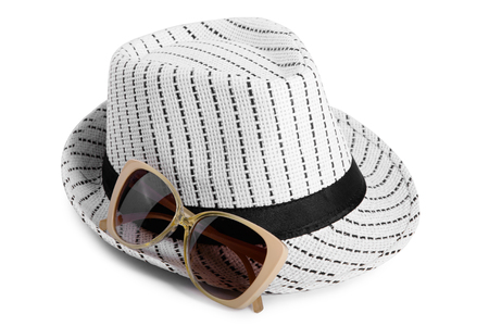 working attire: Striped hat and gold sunglasses isolated on white background