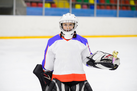 Sport for Kids. Young ice hockey player. Stock Photo