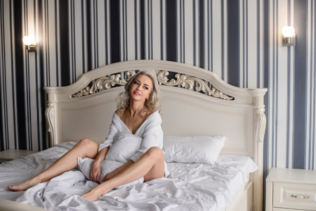Beautiful woman in amazing clothes posing in hotel Stock Photo