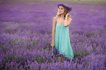 Beautiful blond girl on the lavender field. 免版税图像