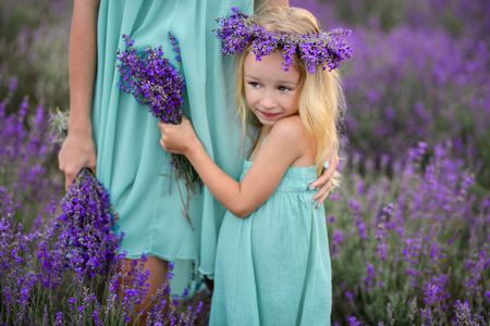 Mom and daughter in a field of lavender.