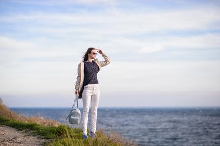 The girl with long hair near the sea Stock Photo