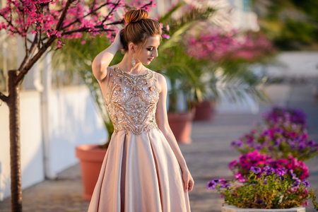Beautiful girl in wedding dress outdoor. Young girl at the prom.