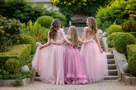Beautiful young girls in amazing dress outdoor. Children bridesmaids Stock Photo