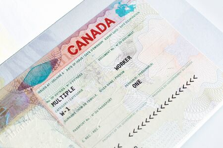 Canadian working visa in passport closeup. Immigration to Canada concept.
