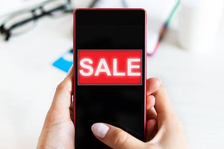 Female hands using smart phone for online shopping. Online shop, sale concept.