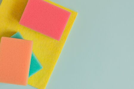 Creativity with cleaning colorful sponges. Copy space. Mockup for design. Archivio Fotografico
