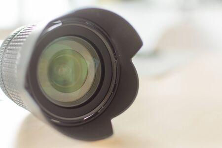 Modern digital camera lense closeup. Black camera lense. Copy space for design. Stock Photo
