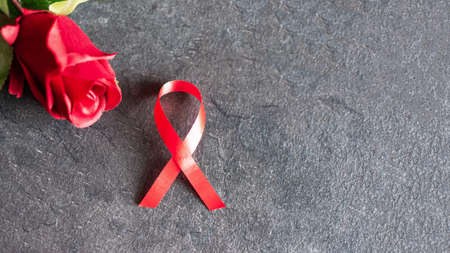 World aids day December 1 with red ribbon, campaign help people with living with HIV. Stock Photo