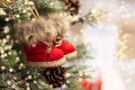 Christmas tree decorated with Christmas stocking toy closeup. Decorated Christmas fir tree. 免版税图像